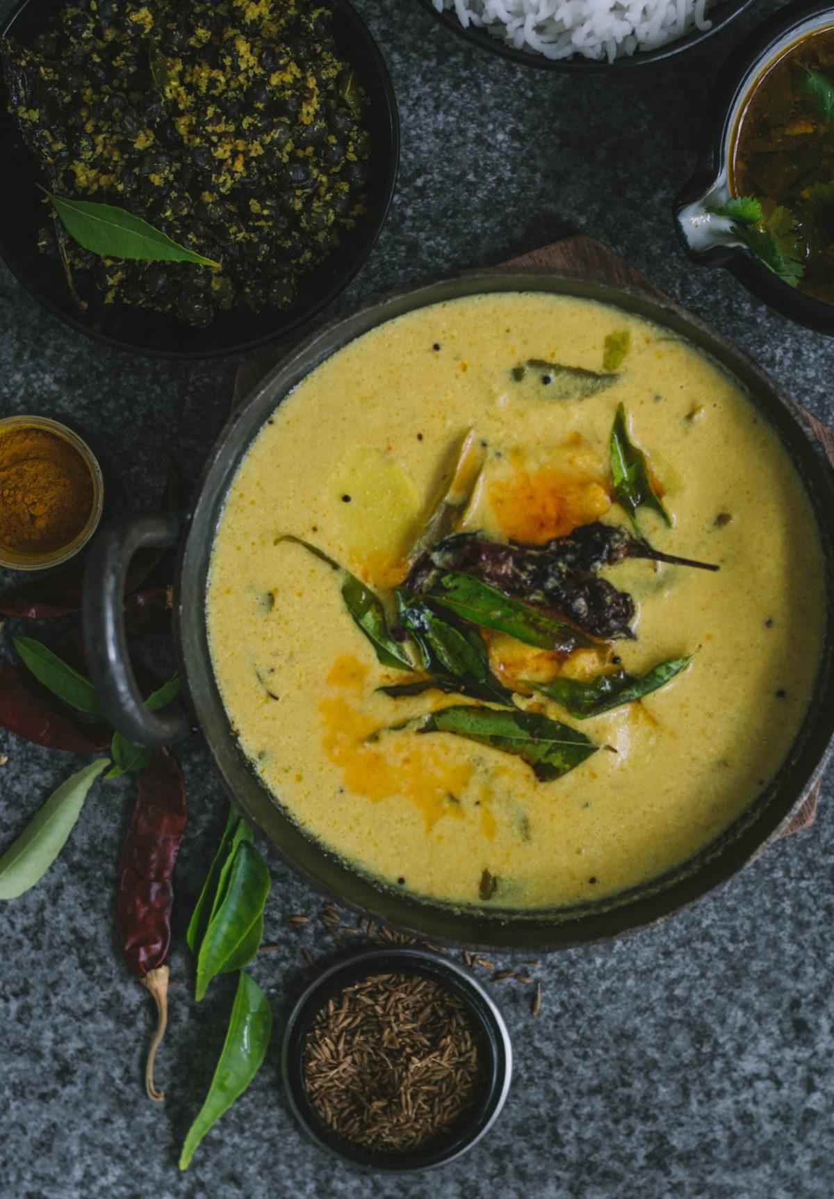 Arbi/ Baby Taro in Spicy Yoghurt Curry (Chembu Moru Curry) - thespiceadventuress.com