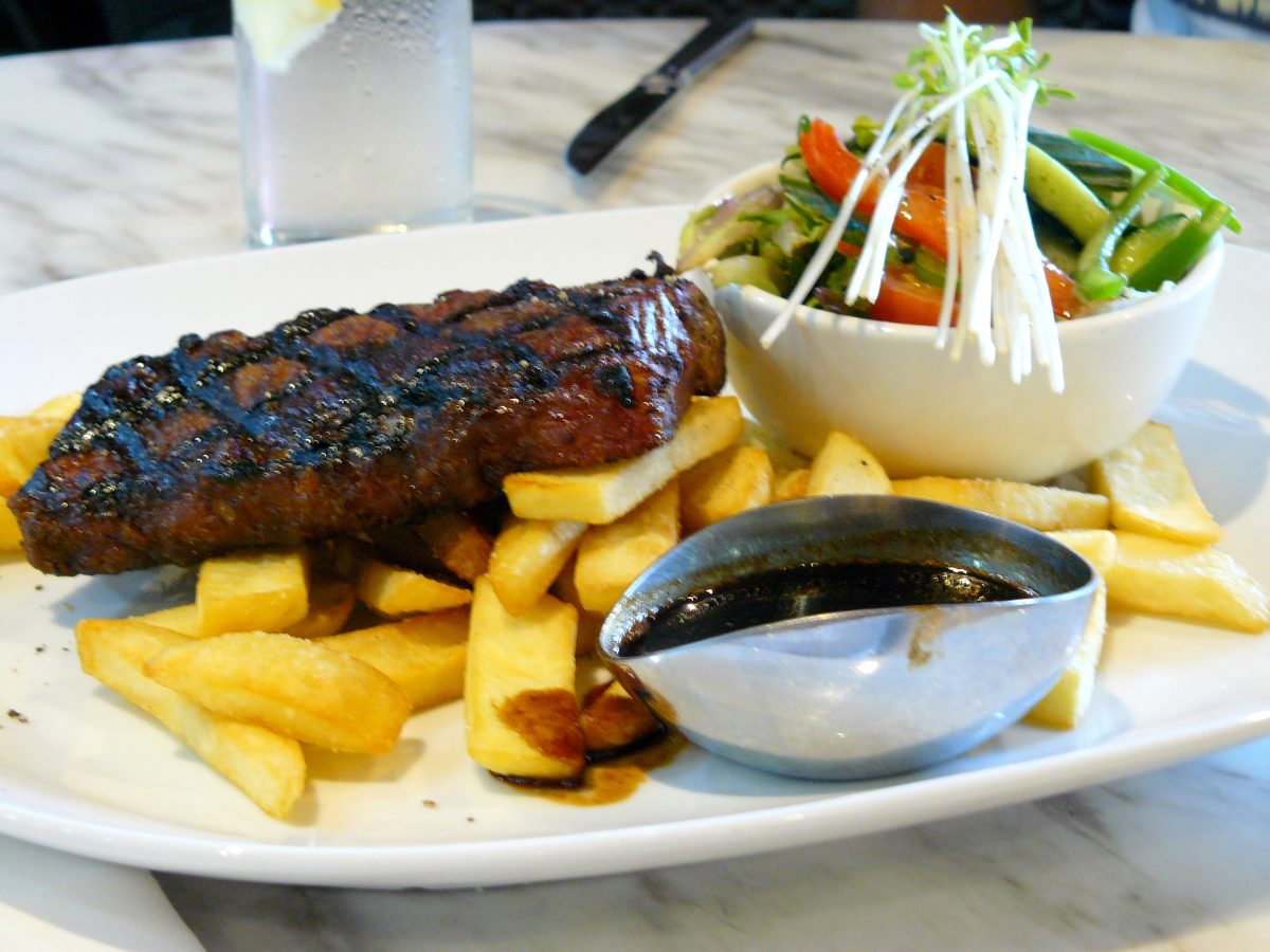 Aged porterhouse with red wine jus, fresh salad and chips