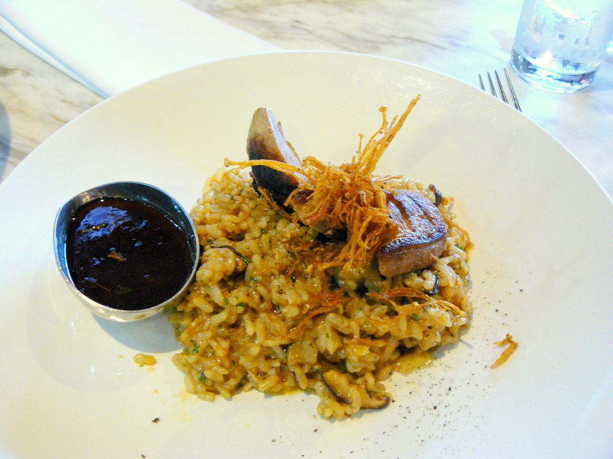 Duck breast served with plum sauce and wild mushroom risotto