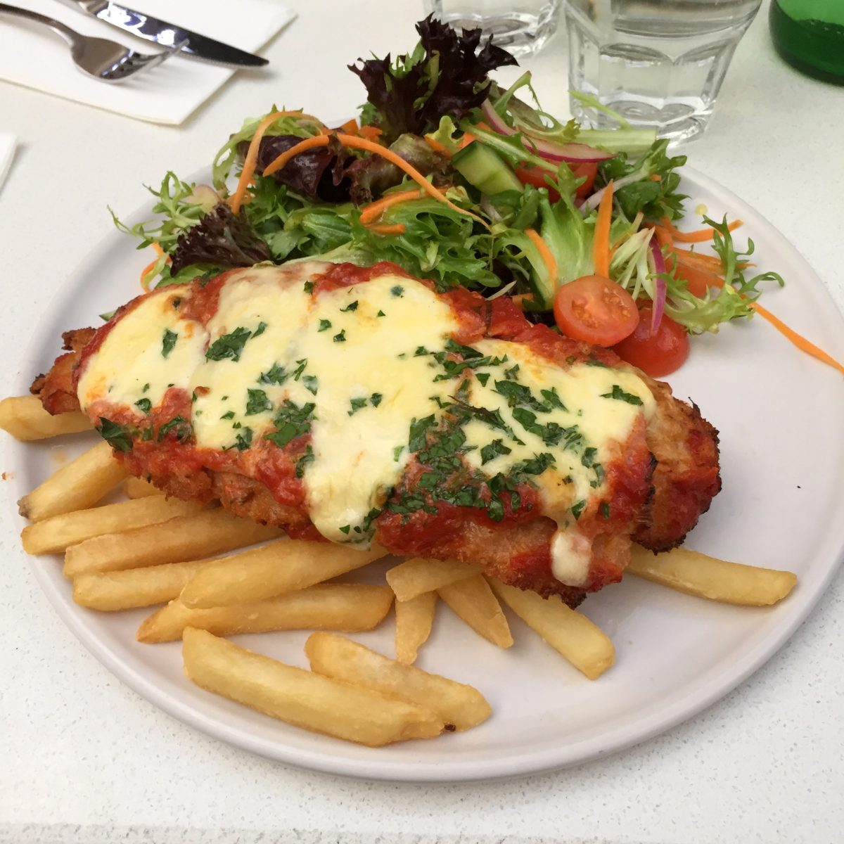 chicken parma with fries and garden fresh salad