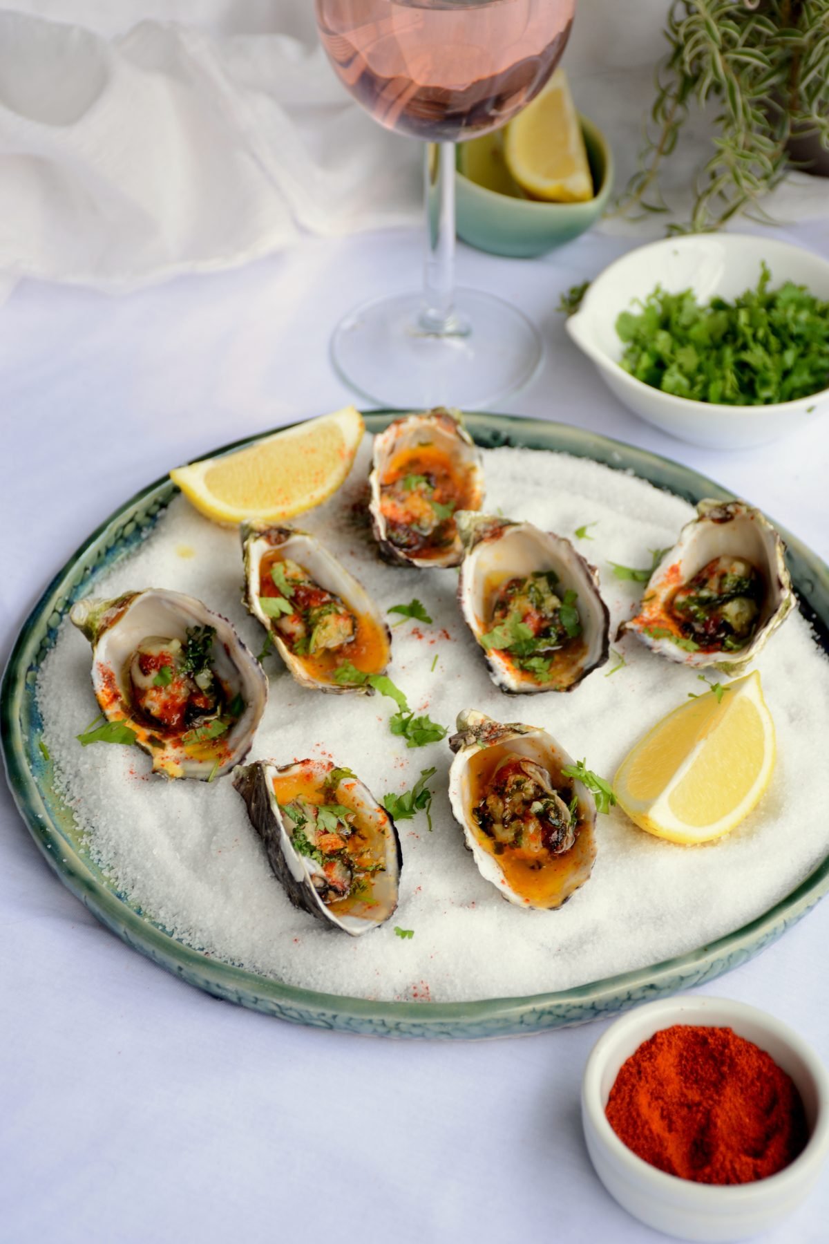 Baked Oysters with Garlic, Curry Leaf and Kashmiri Chilli - Soft, plump and juicy oysters are oven baked with a garlic and curry leaf butter emulsion, coriander leaves and Kashmiri chilli powder - thespiceadventuress.com