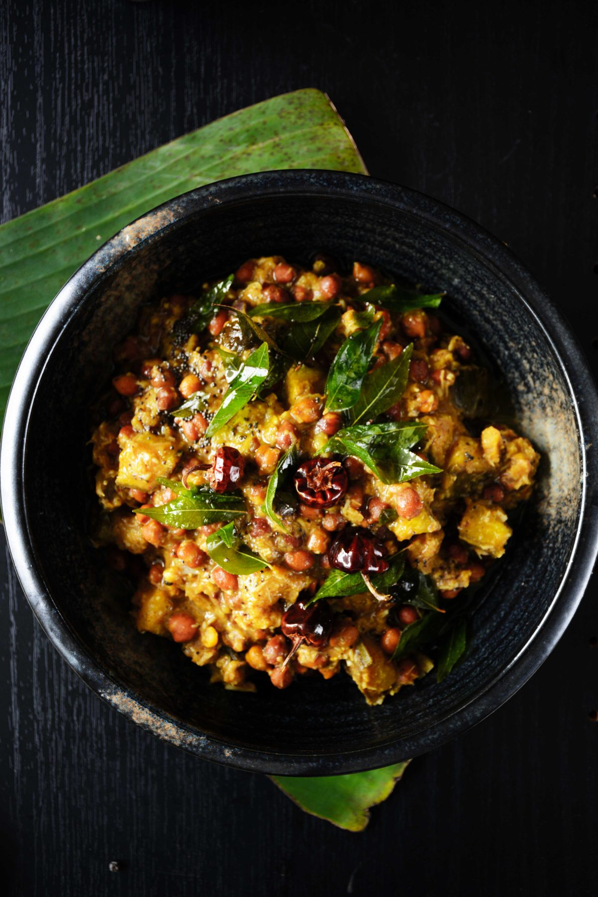 Kootu Curry (Kerala style Black Chickpeas, Plantain and Yam Curry with Coconut and Peppercorns) - thespiceadventuress.com
